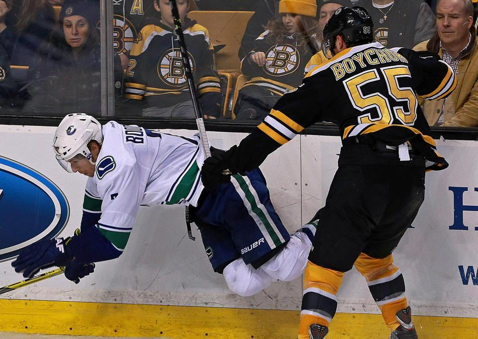 Johnny Boychuk belts Vancouver's David Booth, which apparently can be felt in the seats.
