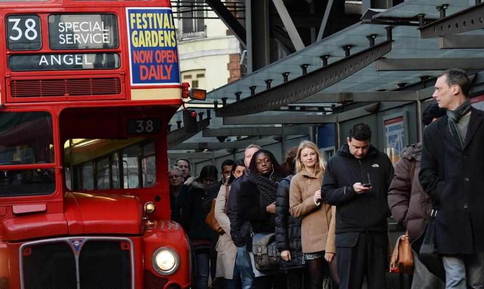 Commuters waited for a bus at Victoria Station in London as unions went on a 48-hour strike over plans to cut 950 jobs.