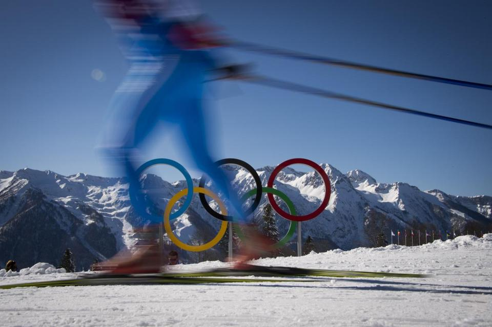 A cross country athlete skied by the Olympic Rings during a training session Thursday at the Laura Cross Country Skiing and Biathlon Centre in Rosa Khutor, Russia.