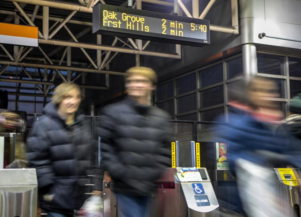 Passengers passed through turnstiles underneath a countdown clock at the Massachusetts Avenue station.