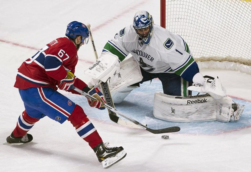 Canucks goalile Roberto Luongo stopped this penalty shot by Montreal's Max Pacioretty during the second period, but Pacioretty still netted a hat trick.