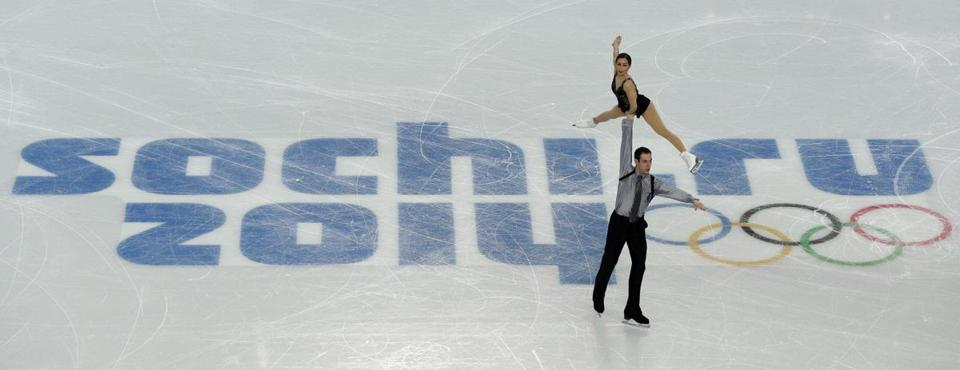 Simon Shnapir and Marissa Castelli of Team USA performed during the Figure Skating Pairs Team Free Program.