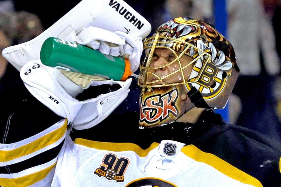 Today's creative paint jobs emphasize masks as art, such as the mask of Bruins goalie Tuukka Rask. But their first mission is safety.