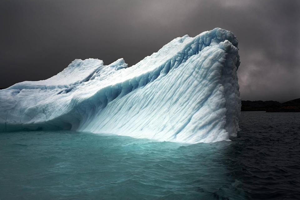 "Camille Seaman's ""Breaching Iceberg — Greenland, August 8, 2008."""