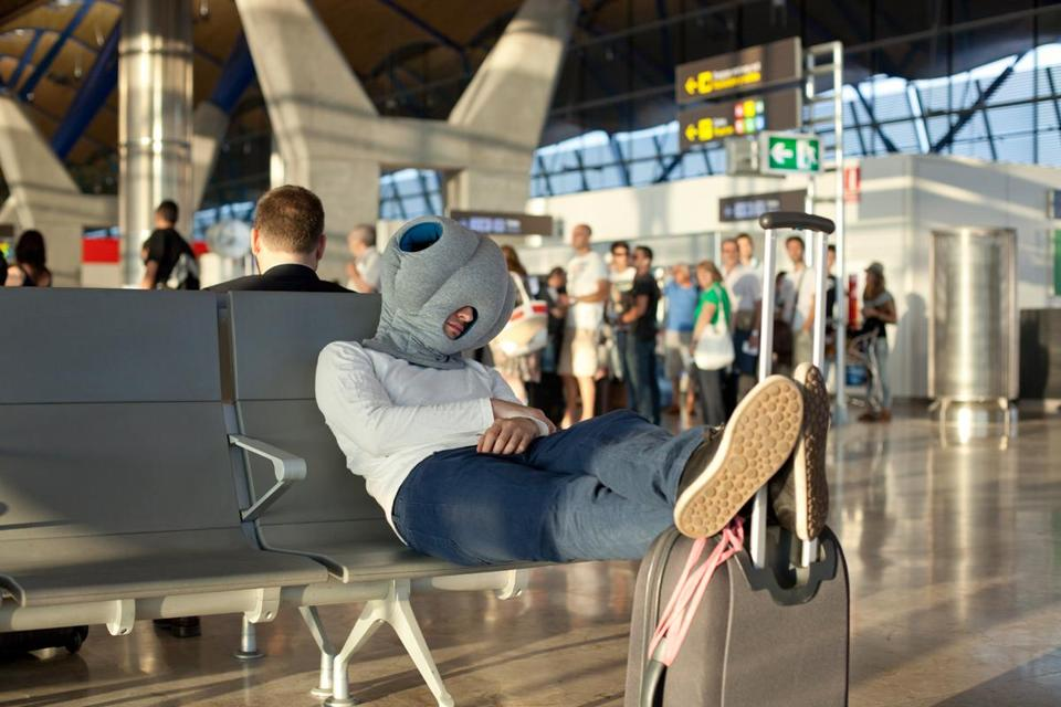 "Makers of the portable Ostrich Pillow say it lets users ""take a comfortable power nap in the office, traveling, or wherever you want."""