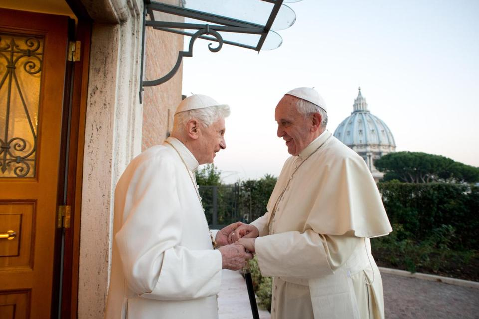 Pope Emeritus Benedict XVI (left) welcomed Pope Francis as they exchanged Christmas greetings at the Vatican last year.