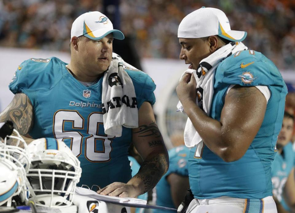 Richie Incognito, left, and Jonathan Martin were teammates on the Dolphins' offensive line until both left the team in the middle of last season.