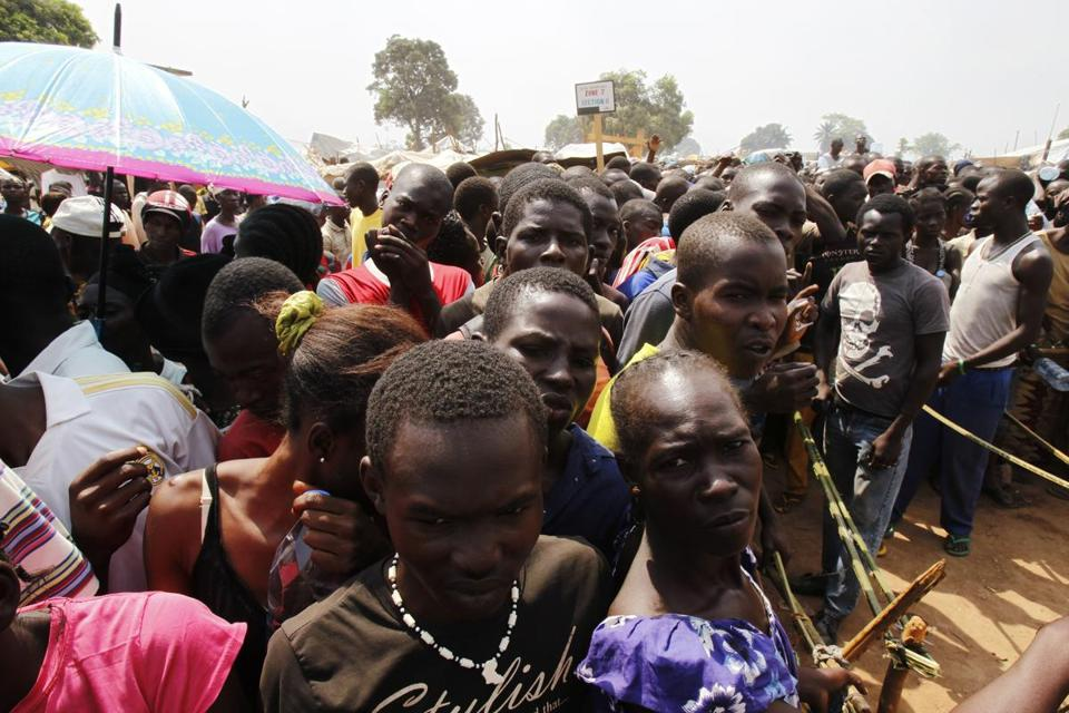 Displaced residents waited to collect food rations at a camp set up at Bangui M'Poko International Airport on Wednesday.