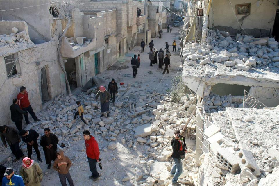 Residents of Aleppo, Syria, surveyed the damage after an airstrike by government forces. The government's bombing of the city has killed an estimated 421 people in the last 12 days.