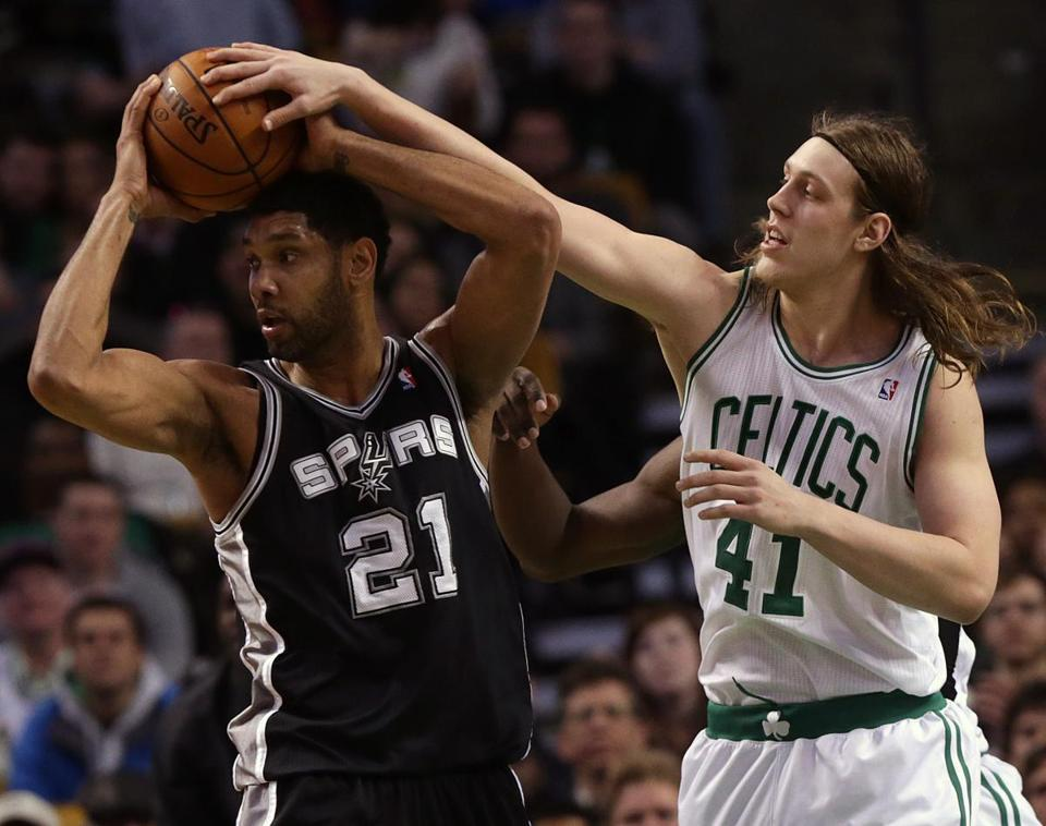 Celtics center Kelly Olynyk tries to play a little defense on Spurs living legend Tim Duncan in the third quarter.