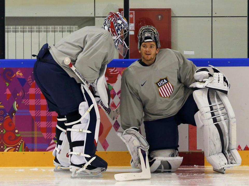 Jonathan Quick, right, huddled with fellow goaltender Jimmy Howard at practice on Friday.