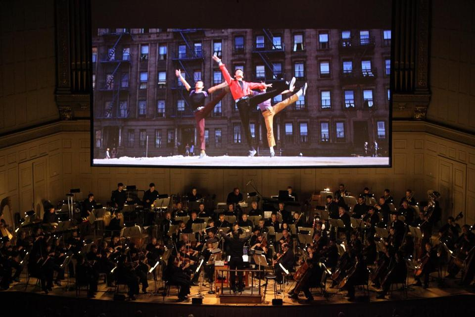 As the orchestra performed, the newly remastered film was shown on large screens with the original vocals and dialogue intact.