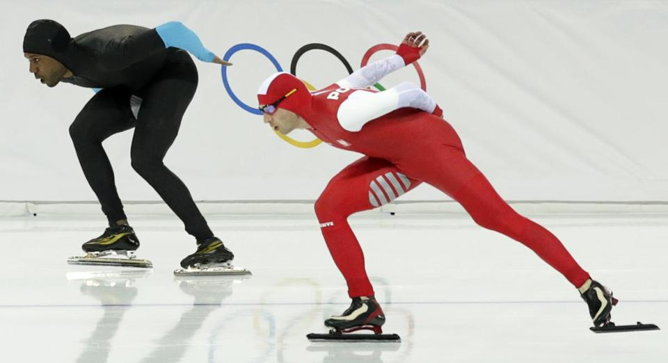 Poland's Zbigniew Brodka, right, and Shani Davis of the US competed in men's 1,500-meter speedskating. Brodka won the gold, and Davis finished 11th.