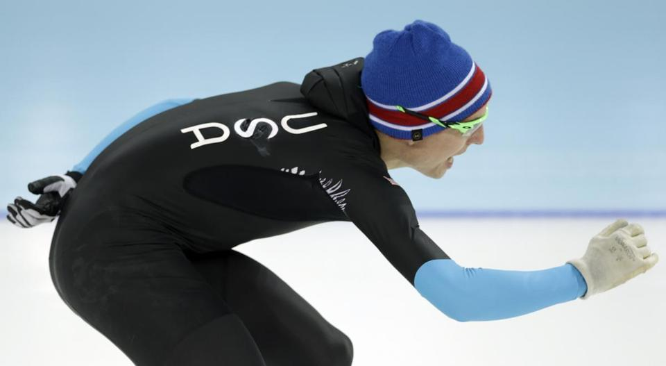 US speedskater Jonathan Kuck warmed up wearing the old race suit, prior to the men's 1,500-meter race on Saturday.