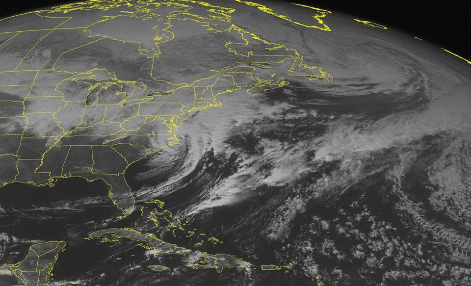 This image taken Saturday afternoon shows the storm system that has brought more snow to the East Coast.