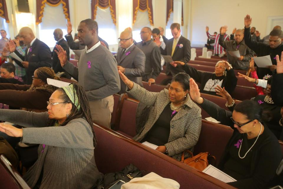 "More than 40 men took ""The Black Man's Pledge of Responsibility."""