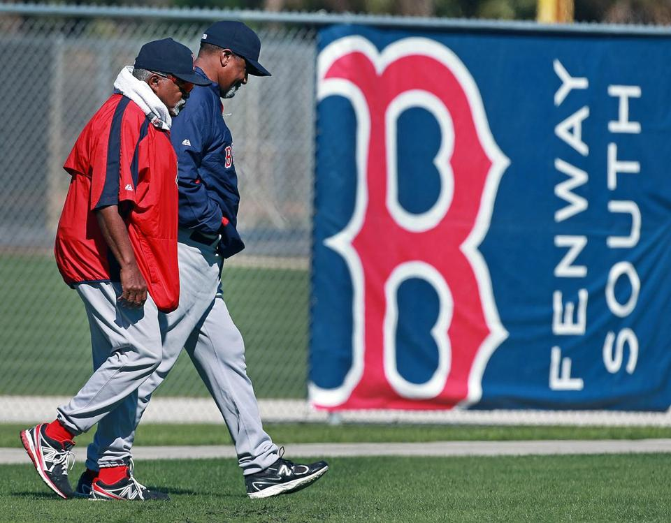 Luis Tiant, left, and Jim Rice walked on outfield grass on Sunday in Fort Myers.