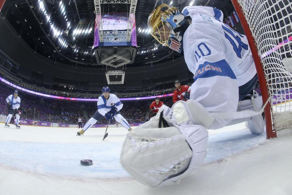 Bruins goalie Tuukka Rask protects Finland's net in Sunday's overtime loss to Canada. Rask made 25 saves.