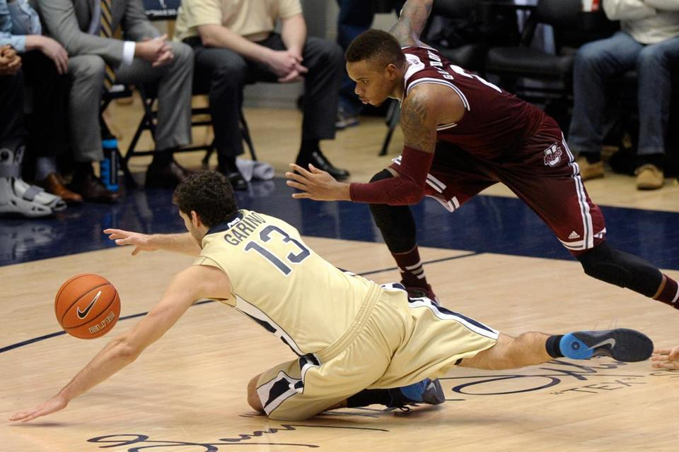 Hustle plays such as this loose-ball pursuit by Derrick Gordon are a big reason UMass earned its 20th win. It's the third straight year the Minutemen have reached that plateau.