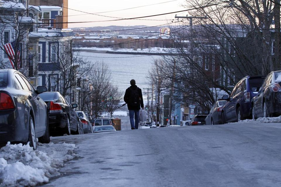 A pedestrian abandoned an icy, snow-clogged section of sidewalk to make his way down G Street in South Boston on Monday.
