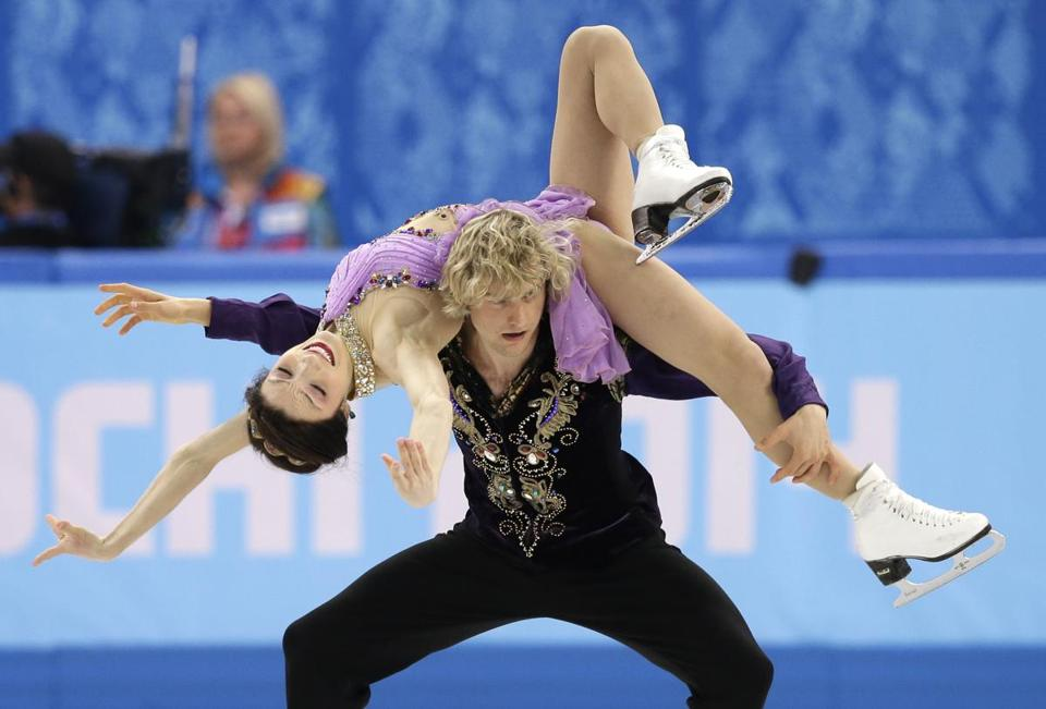 Meryl Davis is lifted by Charlie White during their gold-medal performance in Monday's free dance. (AP Photo/Darron Cummings)