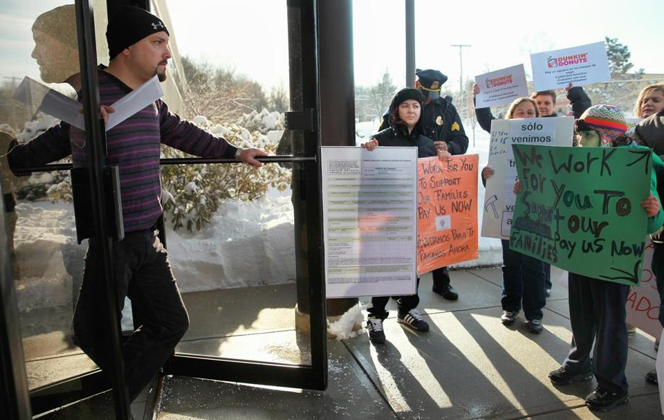 Workers and former workers protested Wednesday outside Fulfillment America, in Billerica, which hired them through Job Done. Brian Healy (top) met with them.