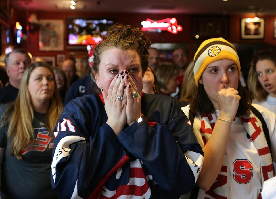 Katelyn Duggan (center), the sister of US team captain Meghan Duggan, reacted with despair Thursday as the team lost 3-2 in overtime to Canada. Family and friends gathered at a pub.