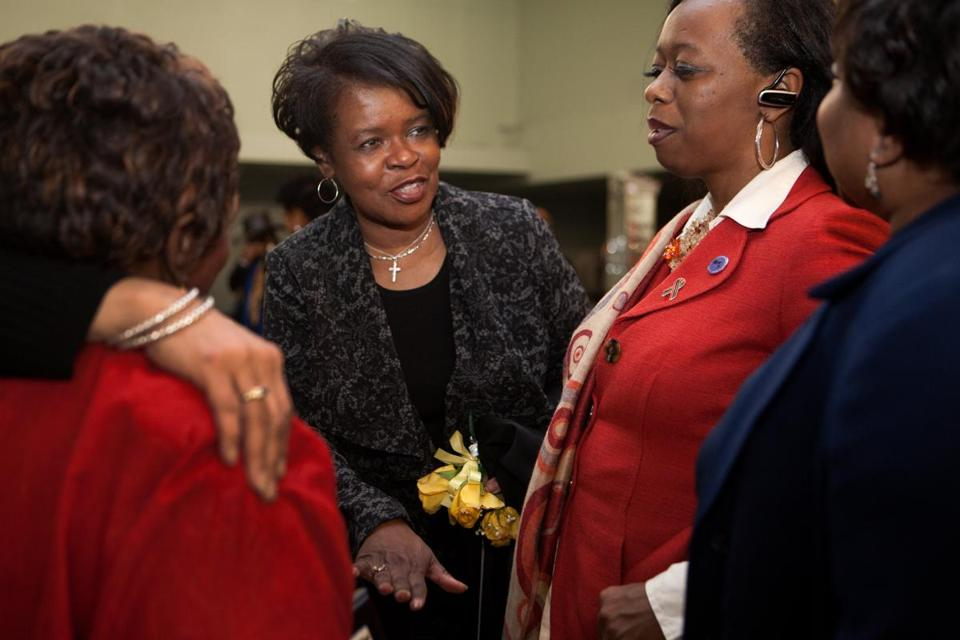 Former state Senator Dianne Wilkerson (center) spoke with friends and supporters in February.