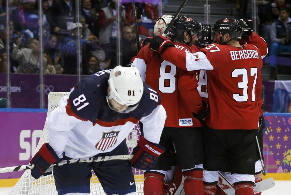 Patrice Bergeron celebrated Canada's semi-final win with his teammates as Team USA's Phil Kessel (left) skated away.