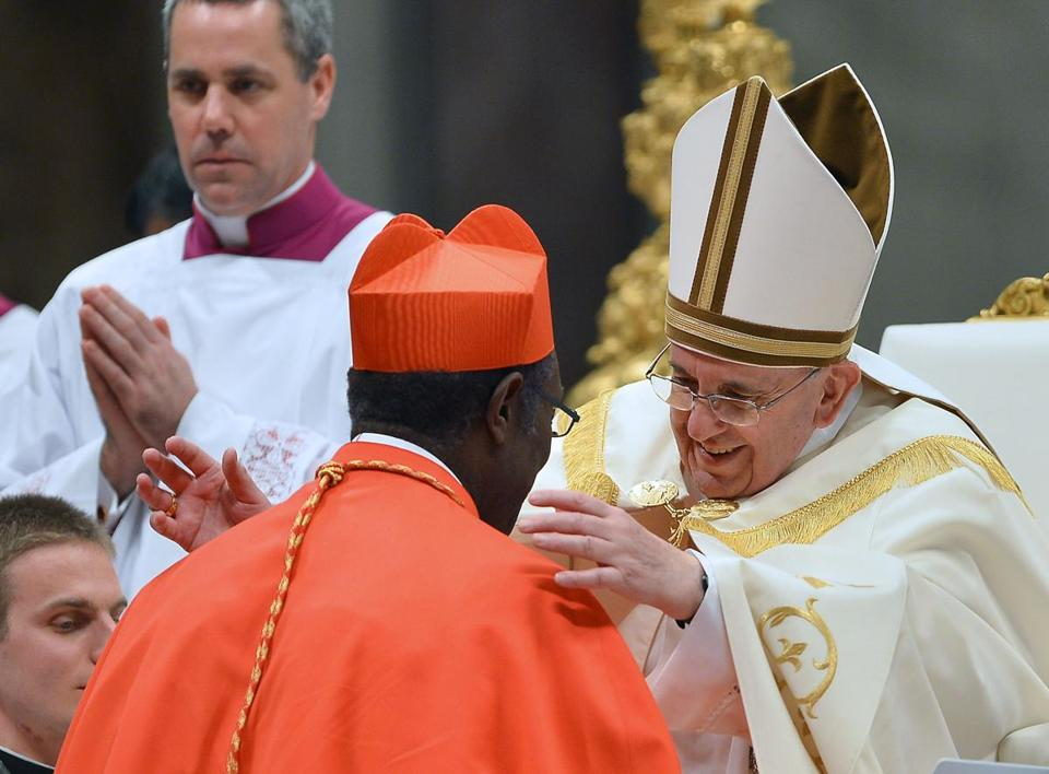 Cardinal Kelvin Edward Felix (left) of Saint Lucia was appointed cardinal by Pope Francis.