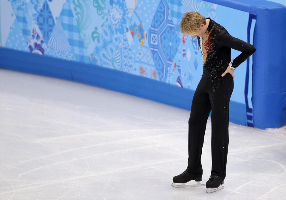 Evgeni Plushenko of Russia left the ice after pulling out of the Olympic men's short program figure skating competition.
