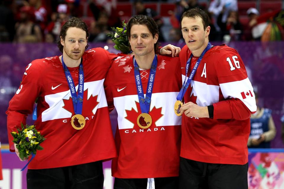 Duncan Keith, Patrick Sharp, and Jonathan Toews showed their gold medals.