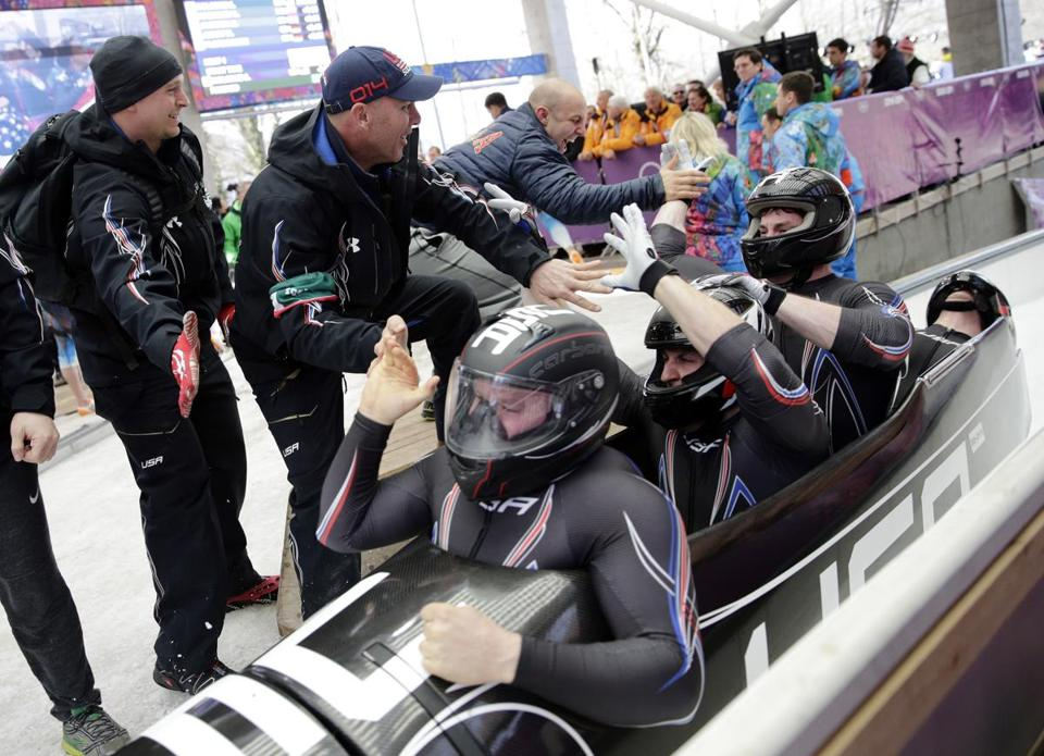 The US team, with Steven Holcomb, Curtis Tomasevicz, Steven Langton and Christopher Fogt, celebrated after they won the bronze medal during the men's four-man bobsled competition.