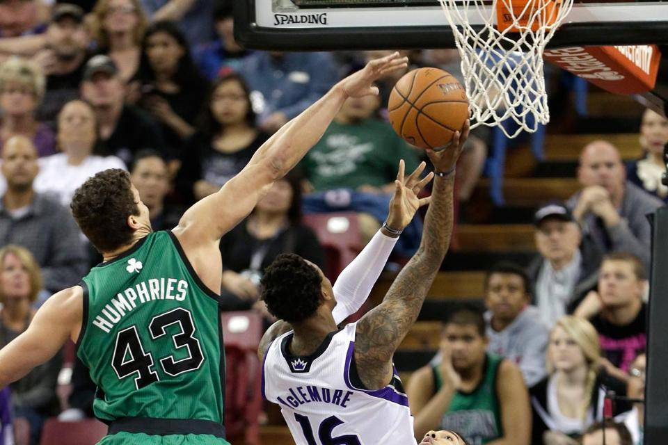 The Celtics' Kris Humphries is too late to stop Ben McLemore's driving layup for the Kings.