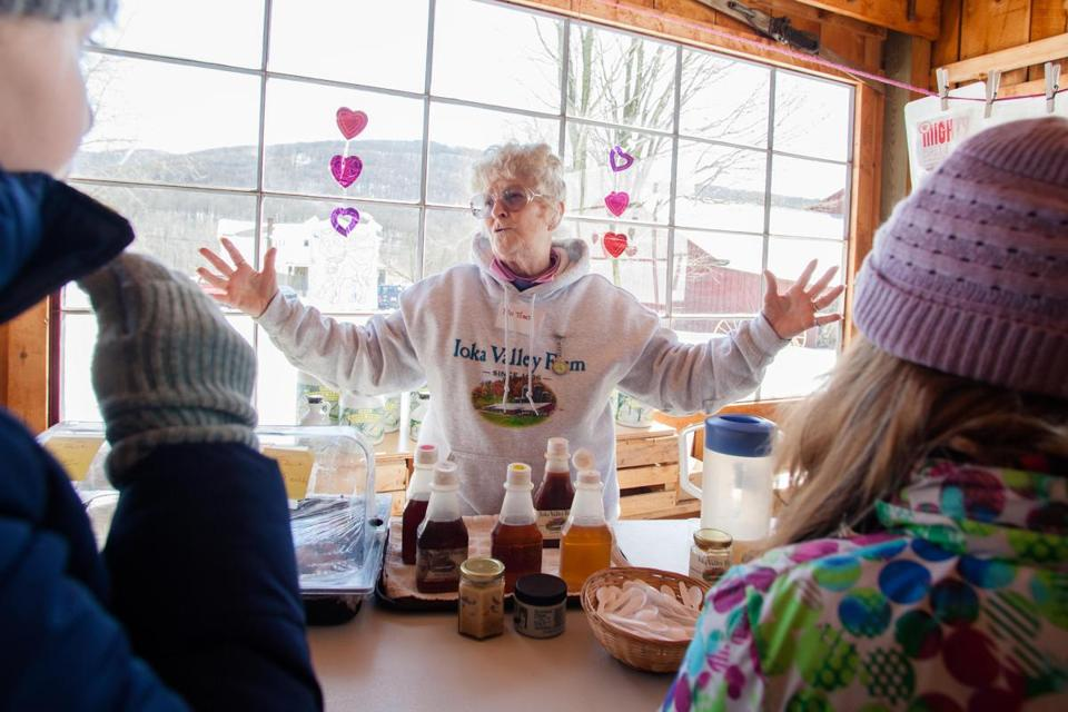 Terrianne Koepp educates customers on the different grades of maple syrup at Ioka Valley Farm in Hancock; the Sugar House exterior.