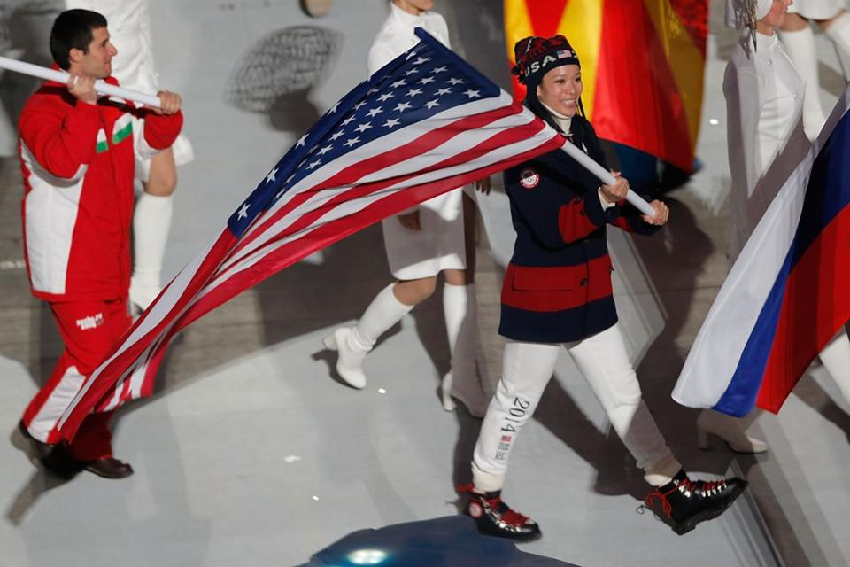 Four-time Olympian and former Harvard hockey player Julie Chu was the US flag bearer in the Closing Ceremony.