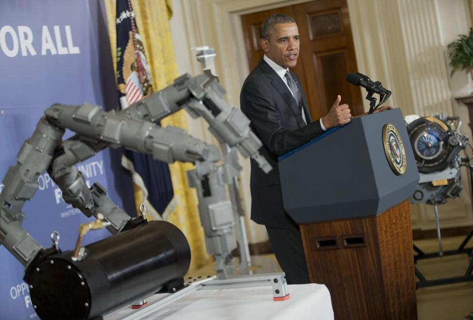 President Obama revealed the sites of manufacturing centers, accompanied by a Navy ordnance disposal robot.