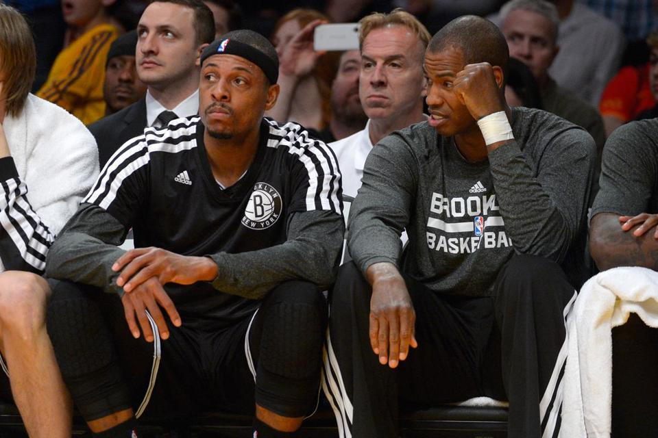 Paul Pierce (left) and Jason Collins, formerly Celtics teammates, chat on the Nets' bench Sunday night. Collins returned to the NBA for the first time since publicly saying he is gay.