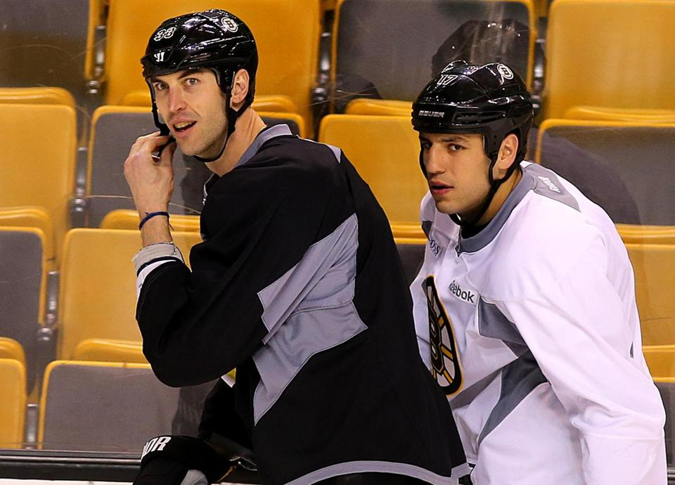 Zdeno Chara, left with Milan Lucic, was back at practice with the Bruins on Tuesday.