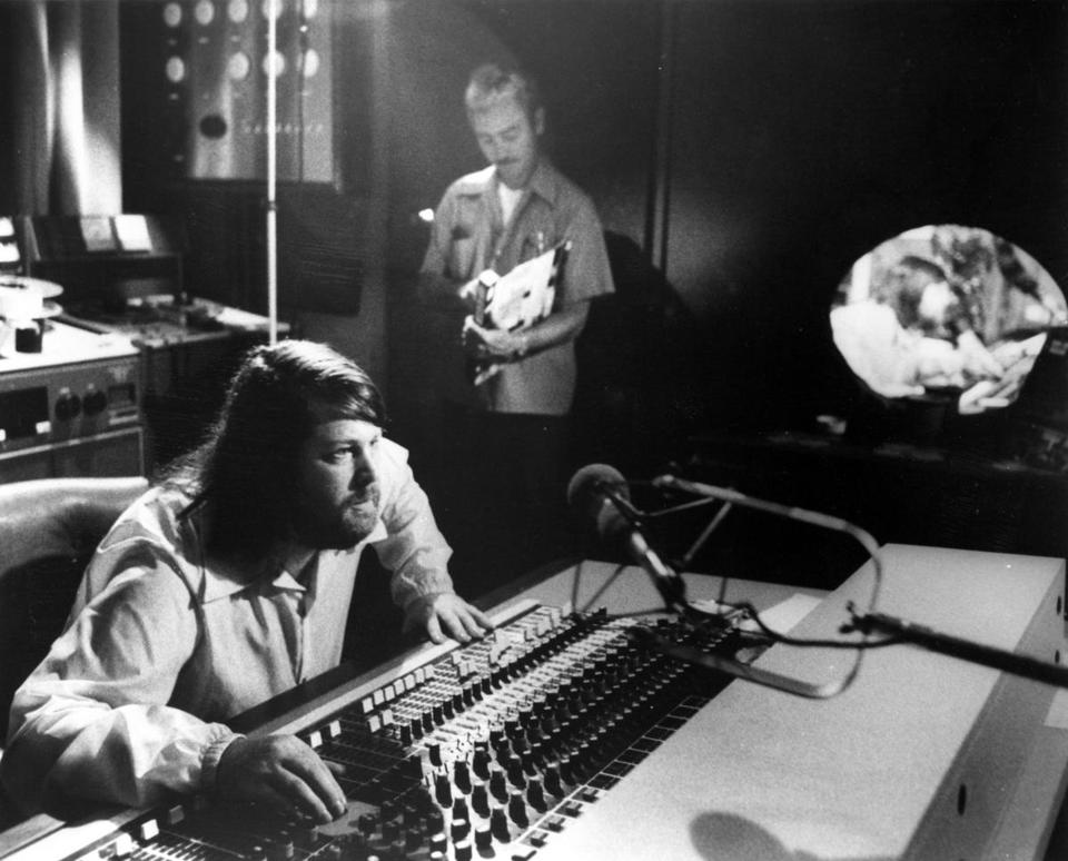 Singer and producer Brian Wilson of the The Beach Boys worked the sound board in a studio in circa 1975.