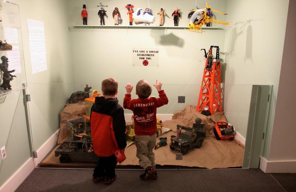Brothers Xavier (left) and Deacon Parsons of Salem study the Wenham Museum's G.I. Joe display.