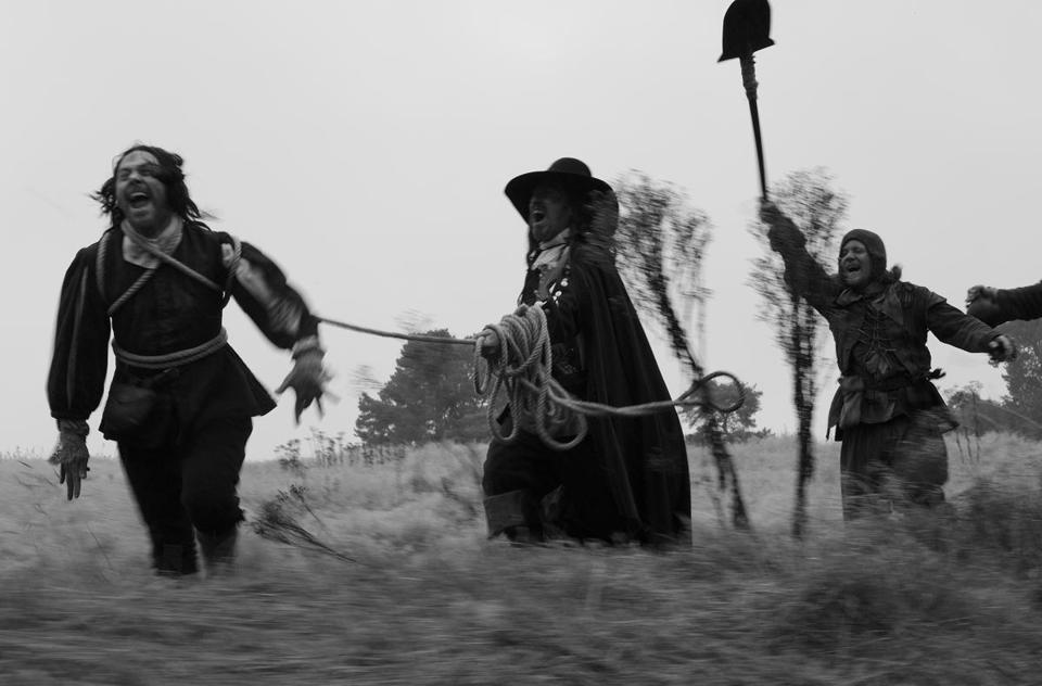 "Reece Shearsmith (left) and Michael Smiley (center) play men in search of  buried treasure during the 17th-century Civil Wars in Ben Wheatley's ""A Field in England."""