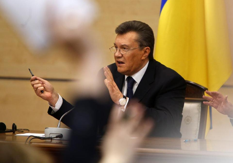 Ukraine's fugitive President Viktor Yanukovych spoke at a news conference on Friday as journalists raised arms to ask questions in Rostov-on-Don, a city in southern Russia about 600 miles from Moscow.