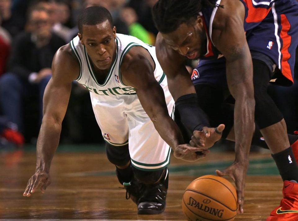 Rajon Rondo makes a key steal against the Hawks Wednesday. Barry Chin/Globe Staff