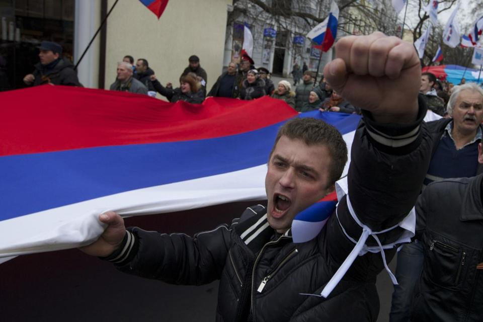 Local residents carried Russian flags and shouted slogans on the streets of Crimean capital Simferopol, Ukraine.