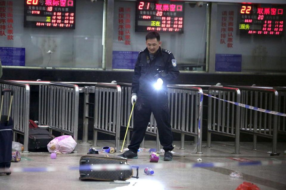 A police investigator viewed the scene in a rail depot, where assailants armed with knives assaulted travelers in Kunming, in southwest China. No group has claimed responsibility.