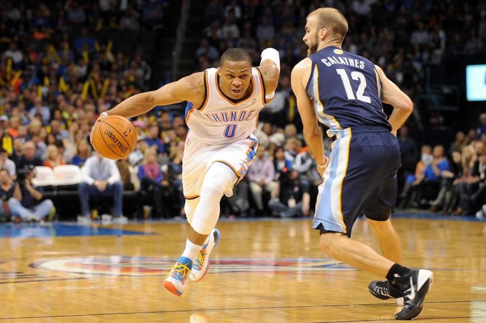 Thunder guard Russell Westbrook, who had 21 points, driove past the Grizzlies' Nick Calathes in the fourth quarter.