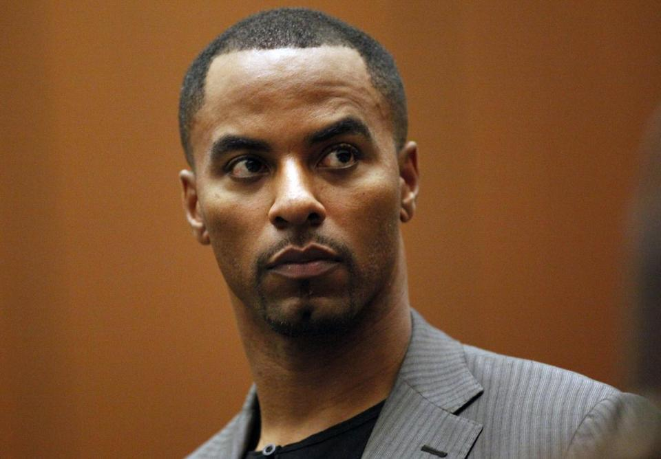 Former NFL All-Pro safety Darren Sharper surrendered to Los Angeles police after being named in a warrant involving a rape case in New Orleans.
