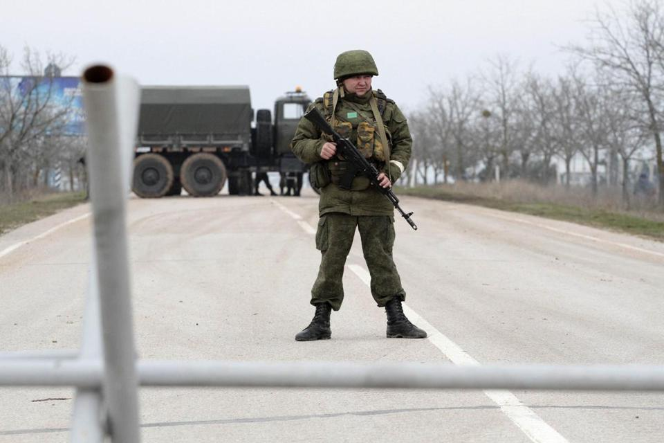 Armed servicemen were on guard at a roadblock at the Belbek airport in Crimea.