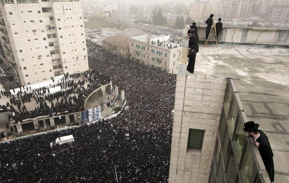 Ultra-Orthodox Jews gathered for a mass prayer to protest the government's plan to require them to serve in the military.